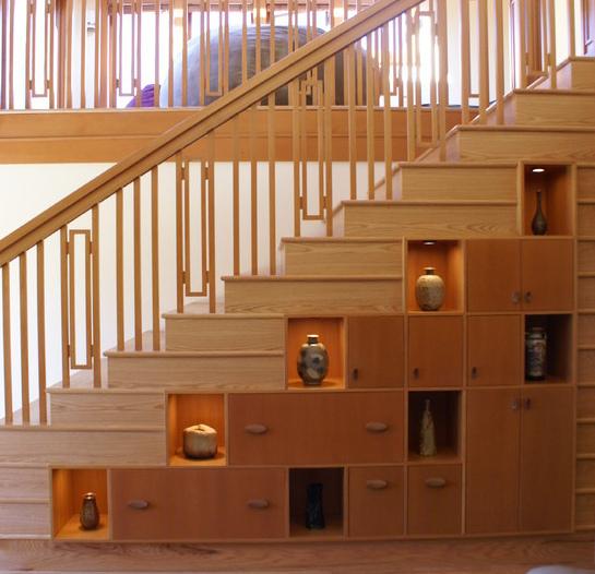 Встроенный шкаф под лестницей фото